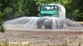A Town of Islip tank truck sprays what