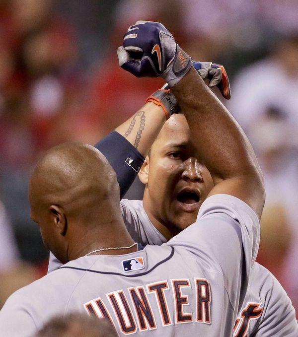 The Detroit Tigers' Miguel Cabrera, right, celebrates his