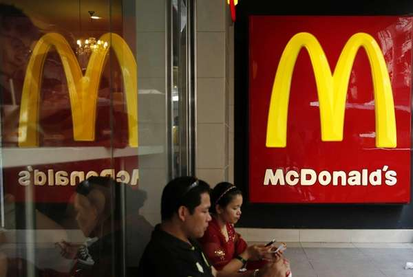 Customers sit at a McDonald's restaurant in Hong