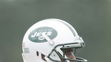 Jets quarterback Geno Smith (7) looks on during