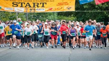 Participants of the 10K race begin running the