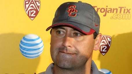 USC football coach Steve Sarkisian takes questions from