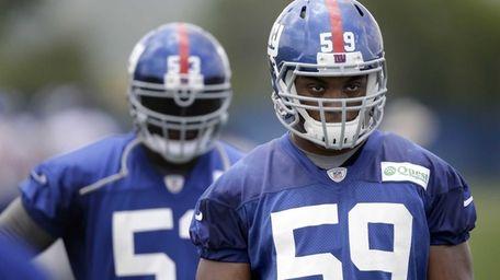 The Giants' Devon Kennard looks on during training