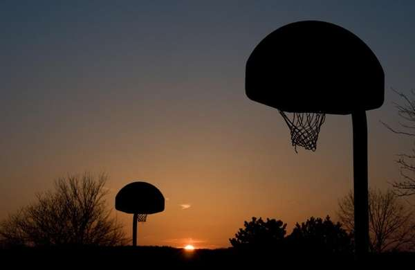 Basketball court at sunset.