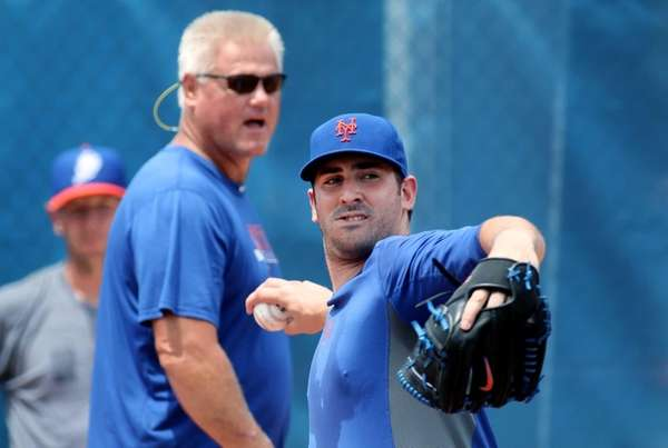 Mets pitcher Matt Harvey, left, works out as