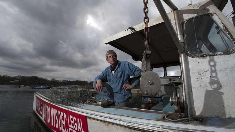 Commercial lobsterman Bob Zickmund on his boat, the