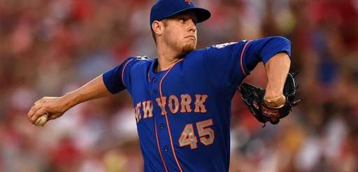 Mets starting pitcher Zack Wheeler works in the