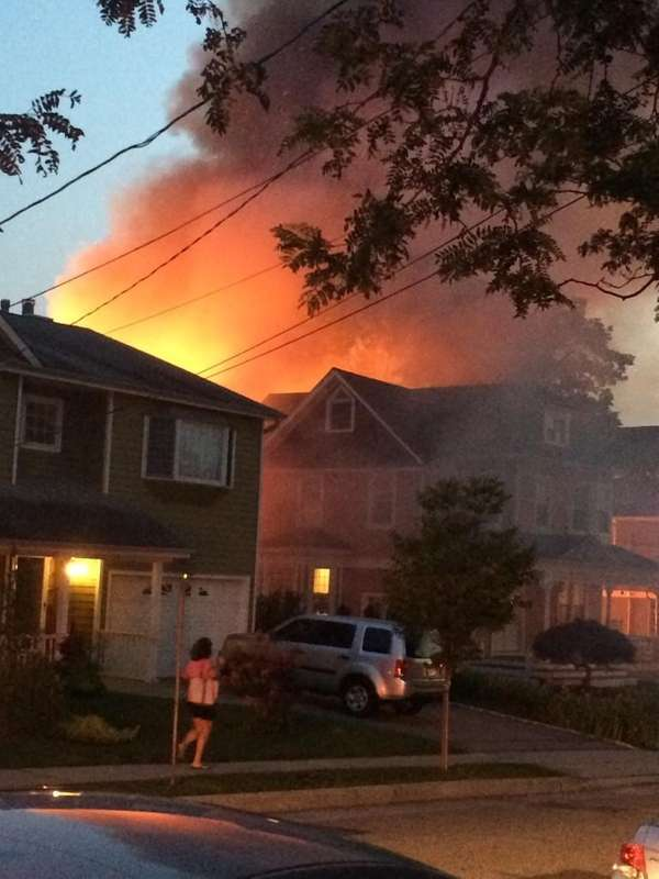 Multiple fire departments battle a large residential blaze