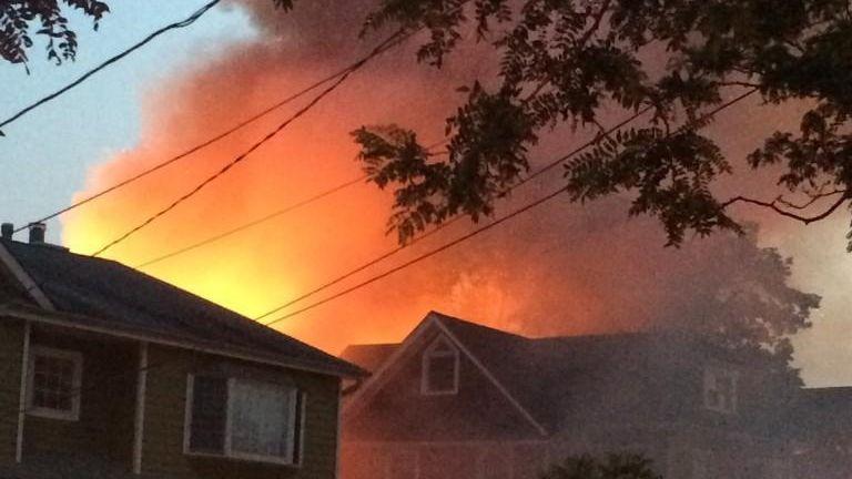 Multiple fire departments battle a large residential blaze