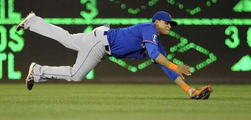 Mets centerfielder Juan Lagares comes down with the
