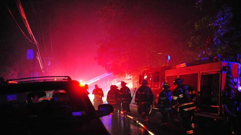 One person died and four firefighters were injured