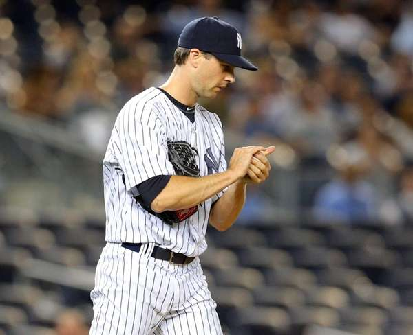 Yankees relief pitcher Matt Daley reacts after allowing