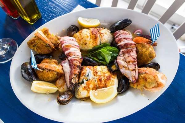 A satisfying seafood platter is served at Nissos