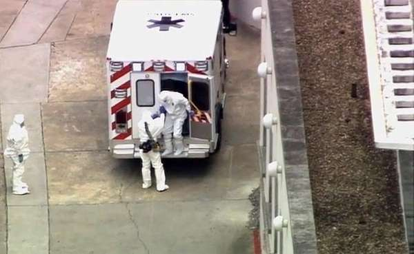 An ambulance arrives with Ebola victim Dr. Kent