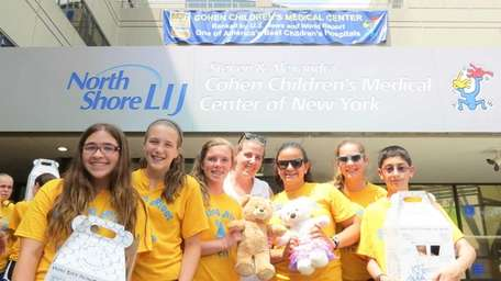 Rolling River Day Camp counselors-in-training show the bears