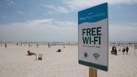 A sign notifies beach goers of the new