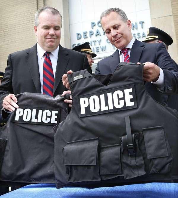 Acting Nassau County Police Commissioner Thomas Krumpter, left,