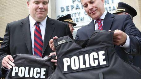 Acting Nassau County Police Commissioner Thomas Krumpter, left,