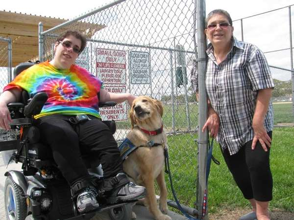 Allyson Martin with her service dog, Daton, and