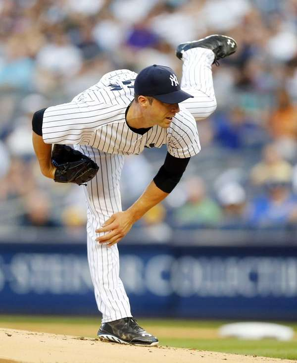 The Yankees' Chris Capuano delivers a pitch in