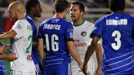 Cosmos defender Hunter Freeman #2 has words with