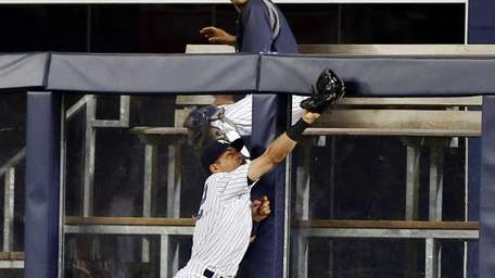Jacoby Ellsbury makes a catch at the wall