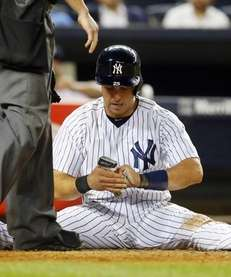 The Yankees' Mark Teixeira looks at his hands