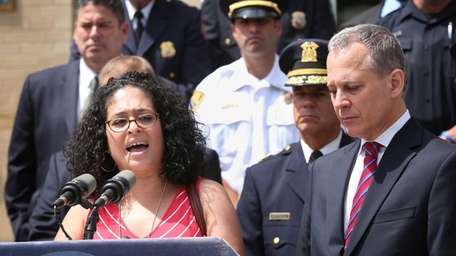 Joining Attorney General Eric Schneiderman, right, at a