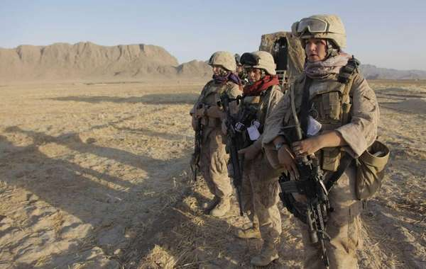 A group of female Marines on patrol in