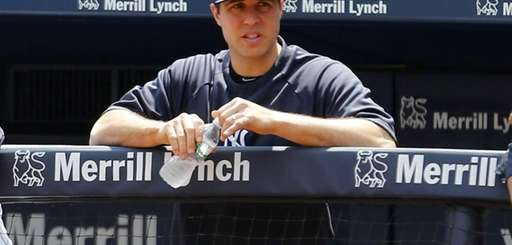 The Yankees' Mark Teixeira looks on from the