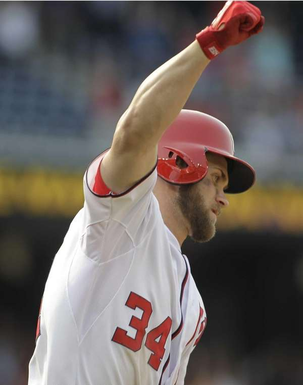 The Washington Nationals' Bryce Harper celebrates his two-run