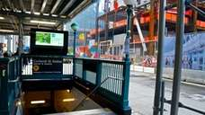 The Cortlandt Street Subway entrance seen across Church