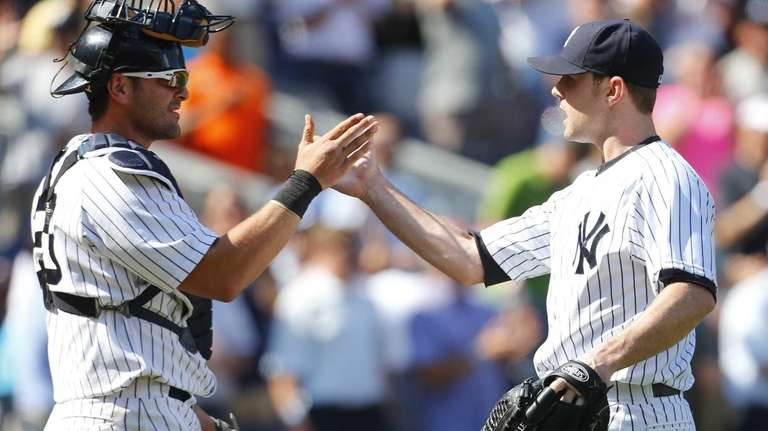 David Robertson celebrates with Francisco Cervelli after getting