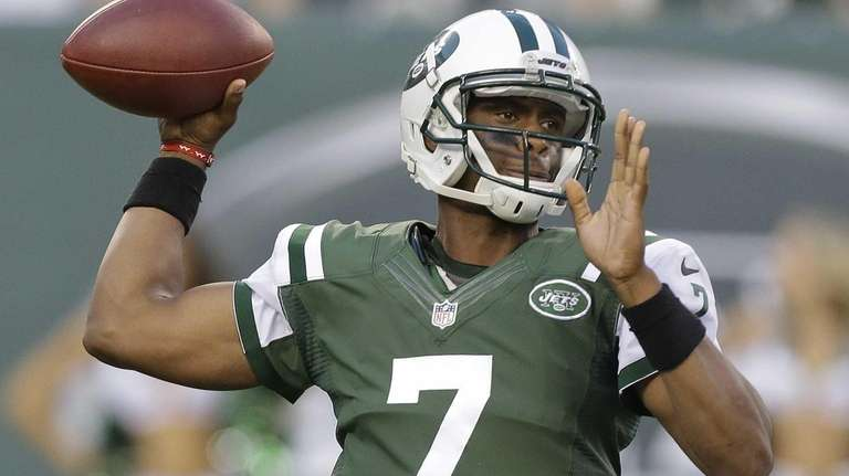 Jets quarterback Geno Smith throws against the Indianapolis