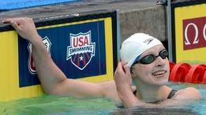 Katie Ledecky reacts after her finish in the