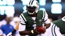 Quarterback Michael Vick of the Jets drops back