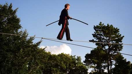 Philippe Petit walks a high wire during the