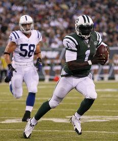 Jets quarterback Michael Vick (1) runs during a