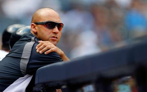 The Yankees' Derek Jeter looks on from the
