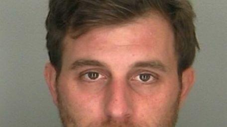 Michael Petikas, 31, of Floral Park, was arrested