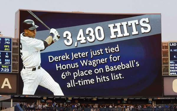 The scoreboard is seen after Derek Jeter #2