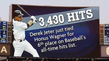 The scoreboard is seen after Derek Jeter #2