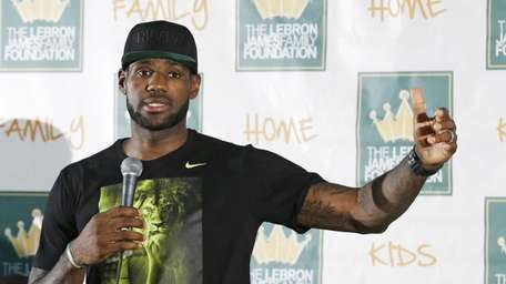 Cleveland Cavaliers' LeBron James answers questions during a