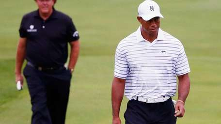 Phil Mickelson of the United States and Tiger