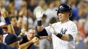 Carlos Beltran #36 of the Yankees celebrates his