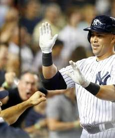 Carlos Beltran #36 of the Yankees celebrates his