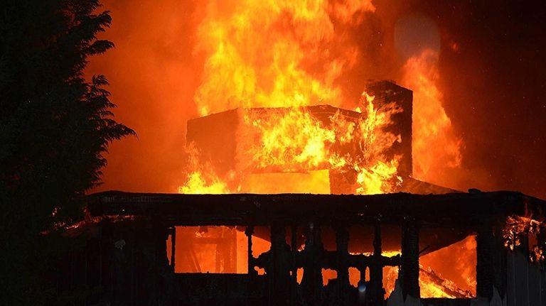 A blaze burned the vacant Lake Grove School