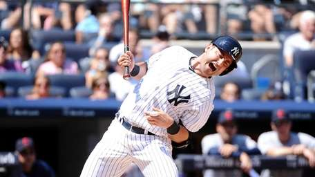 Francisco Cervelli of the Yankees is hit by