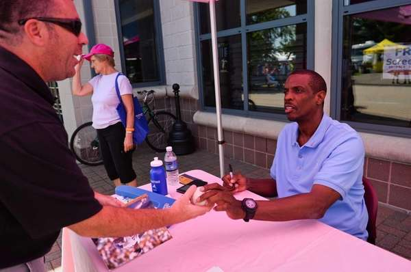 Dwight Gooden signs a baseball for Danny O'Keefe,