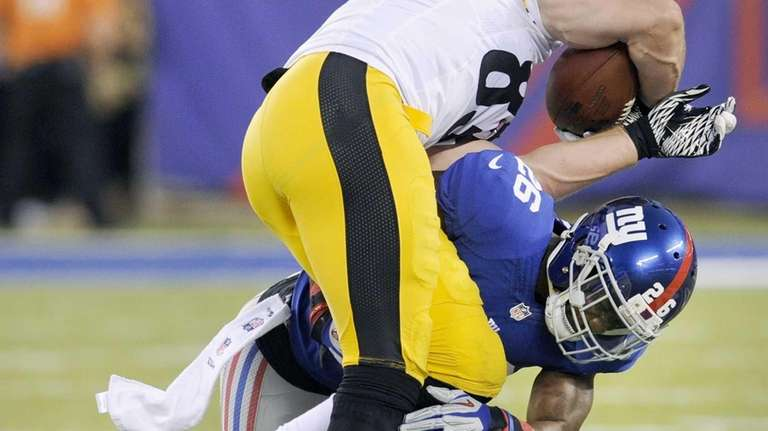 Giants strong safety Antrel Rolle upends Pittsburgh Steelers